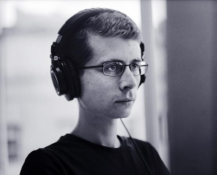Developer with headphones working
