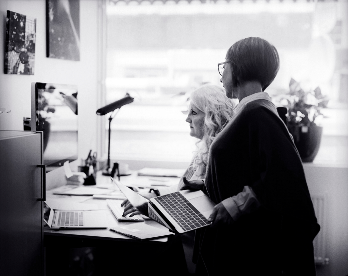 Colleagues working by desk