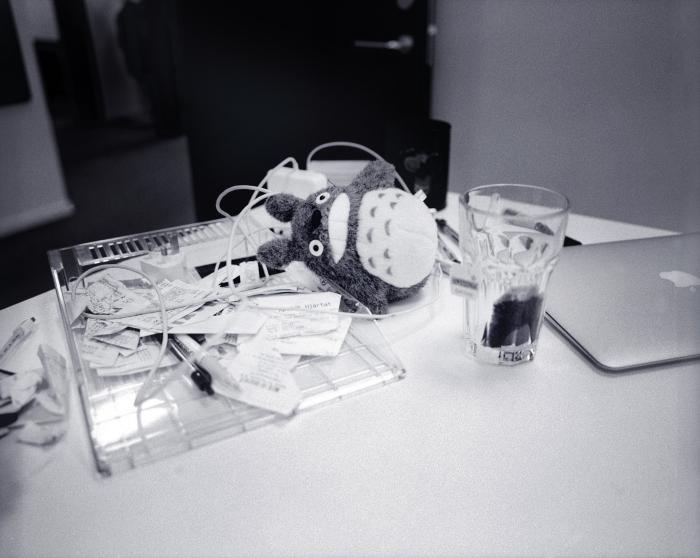 Totoro plush on a messy desk