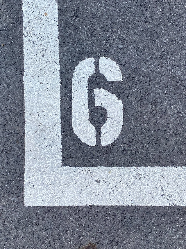The number six painted on the ground