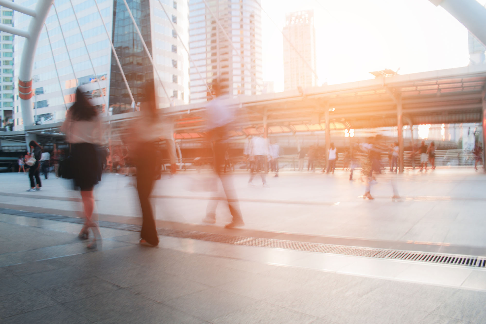 bright light behind pedestrians representing lunavi illuminating technology solutions