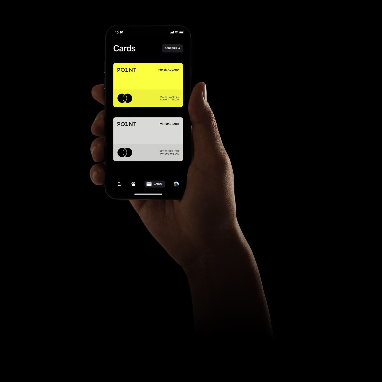 A hand holds up a phone displaying the Point App, on a black backdrop