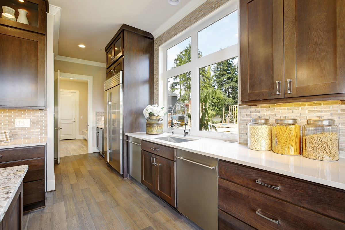 oak cabinets with white quartz countertop