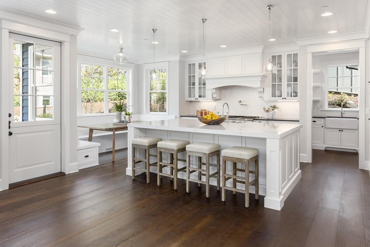 Modern white kitchen quartz countertop with white cabinets