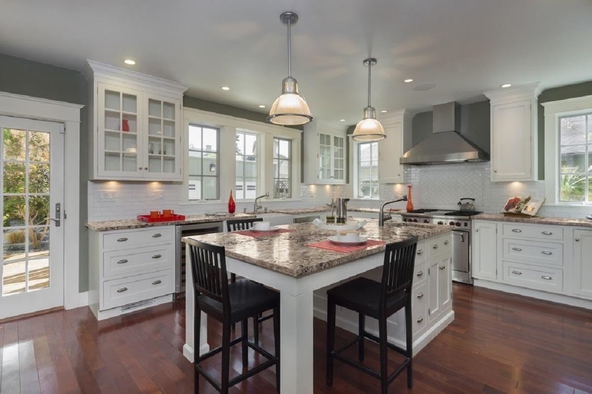 Modern beige kitchen quartz countertop with white cabinets