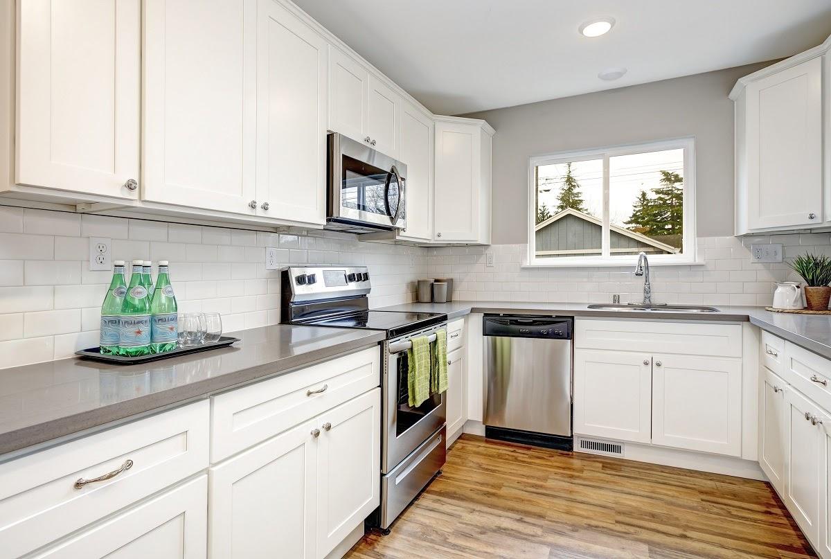 Modern gray kitchen quartz countertop with white cabinets