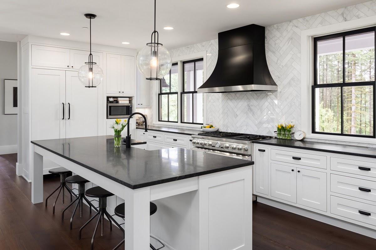 Modern black kitchen quartz countertop with white cabinets