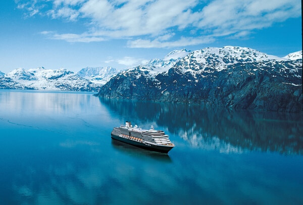 Holland America Line cruise ship sailing past glaciers