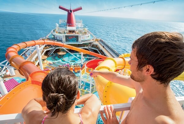 Young cruise ship guests preparing to get on the water slide on a Carnival cruise ship