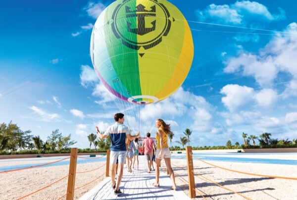 Travelers approaching the hot air balloon at Royal Caribbean's Perfect Day at Cococay island