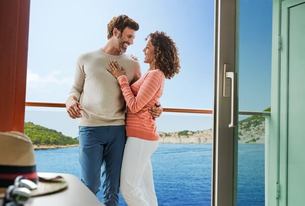 Couple hugging on cruise ship balcony
