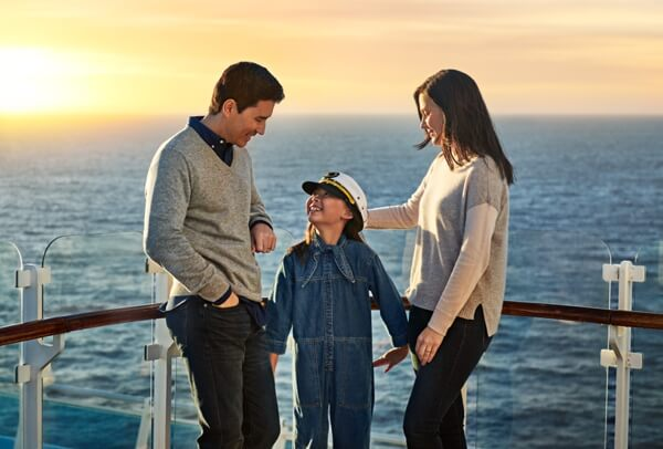 Family on a cruise standing near railing