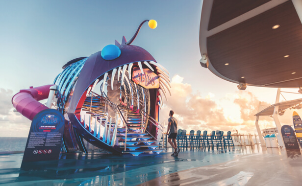 Cruise guest approaching the Ultimate Abyss slide