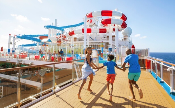 Family excitedly running along the cruise ship deck