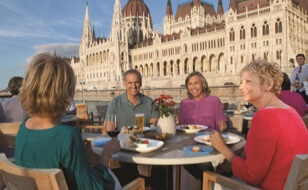 Cruise guests dining al fresco on Viking's Aquavit Terrace