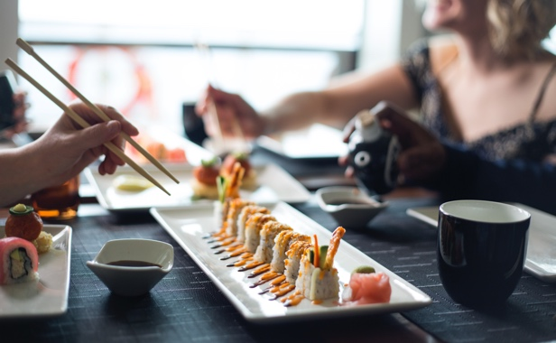 Cruise line guests dining on sushi