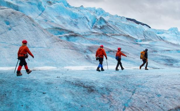 Tourists walking on ice glacier in Antarctica