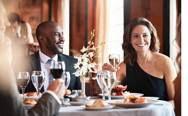 Couple enjoying a formal dinner aboard a cruise