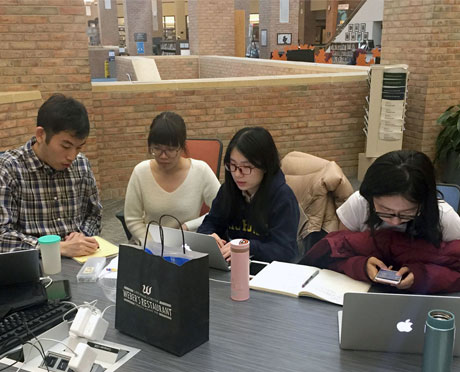 Photo of a group of people using notepads and smartphones