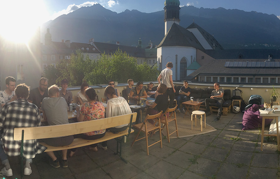 Panoramic photo of our rooftop terrace, with the mountains of Nordkette in the background