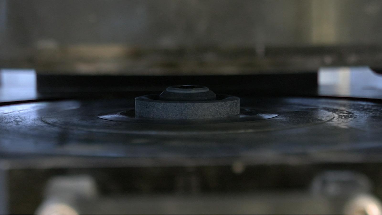 Machine door closing on carbon disc