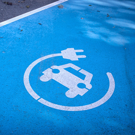 Parking space with electric vehicle charging point