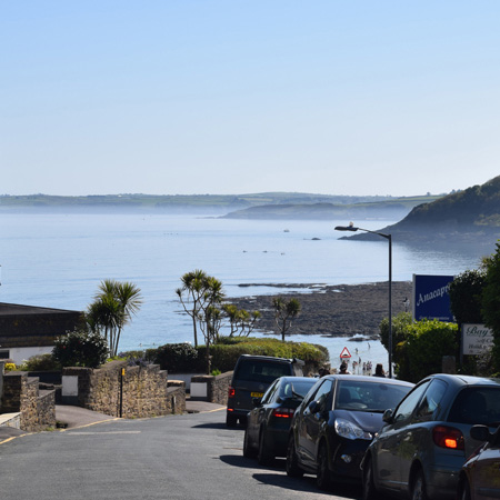 A beautiful coast line street busy with parked cars