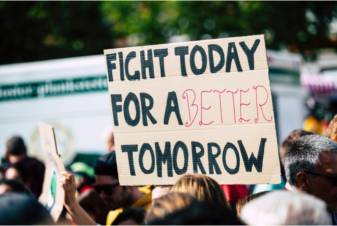 """Climate change protest with sign reading """"fight for a better tomorrow""""."""