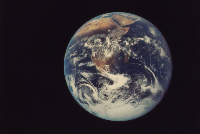 The planet earth being viewed from space, where the effects of climate change are evident.