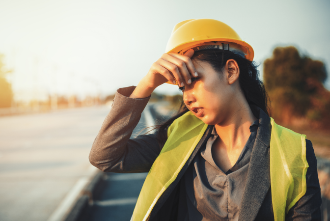 A female construction worker at risk of heat stroke due to working in extreme heat