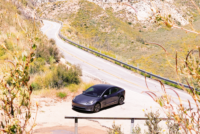 Electric vehicle parked on mountain road