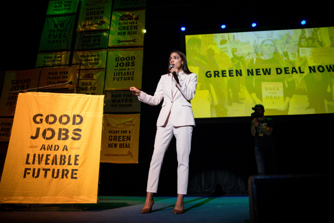 Alexandria Ocasio-Cortez presenting on a stage