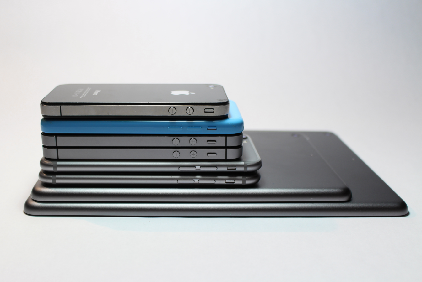 Tablets and smart phones stacked from largest to smallest