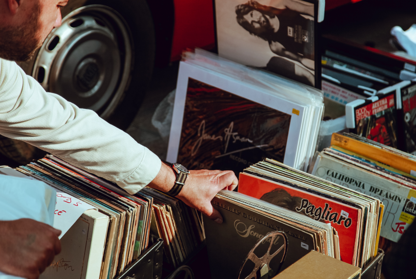 Man reaching into bin of old LP records