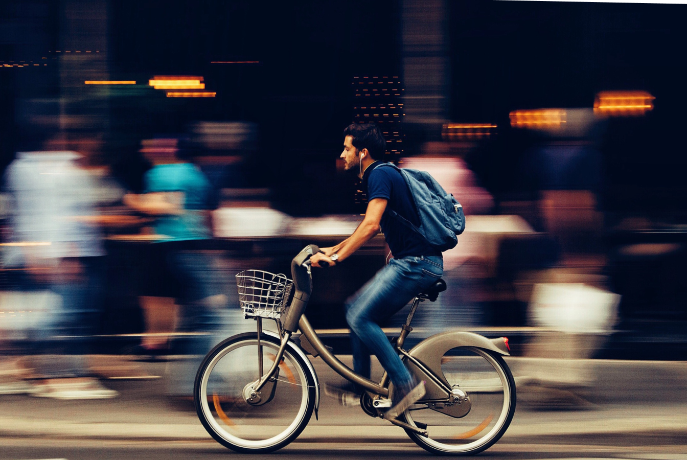 Man using an electrically assisted bicycle as an alternative to driving