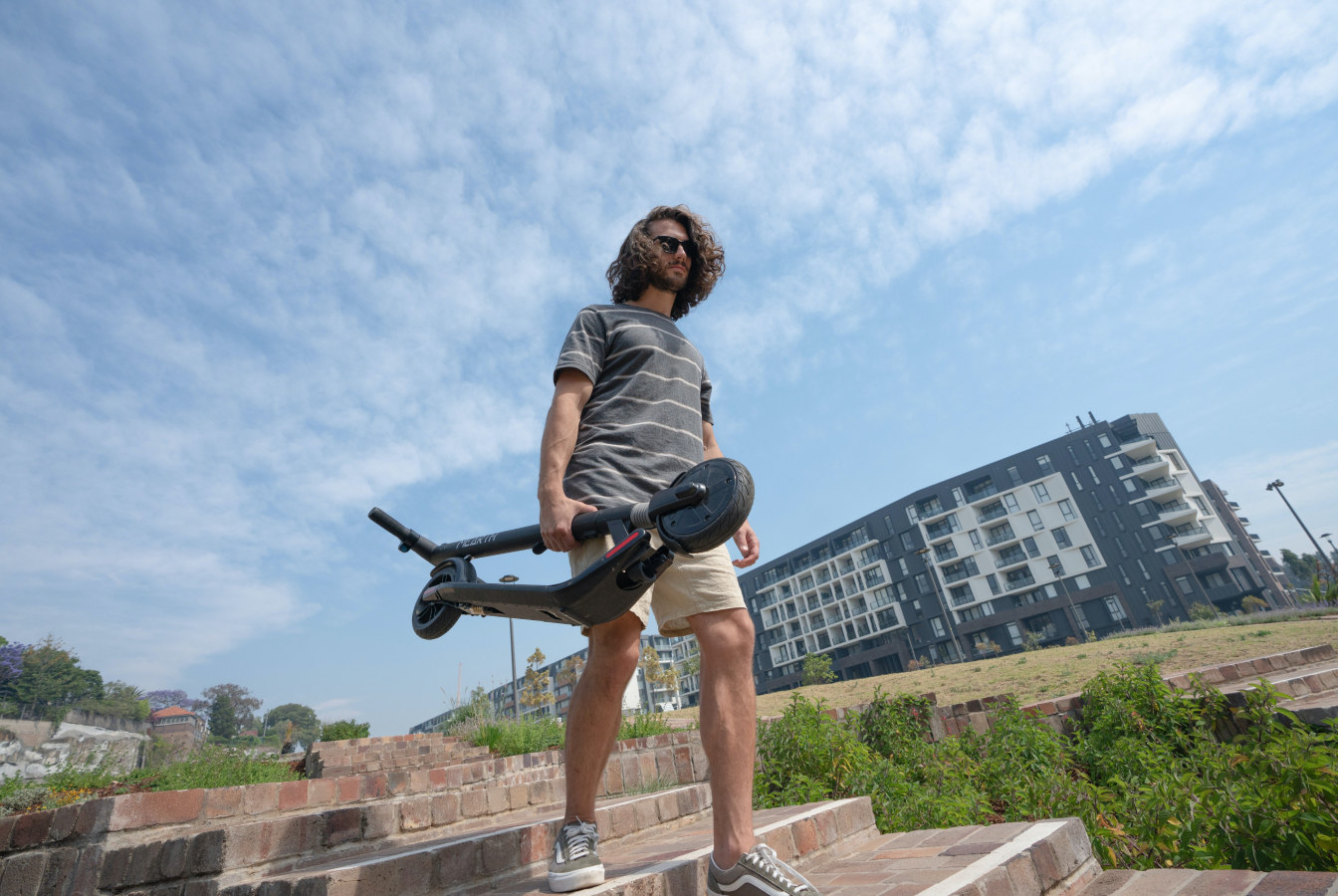 Man carrying electric standup scooter