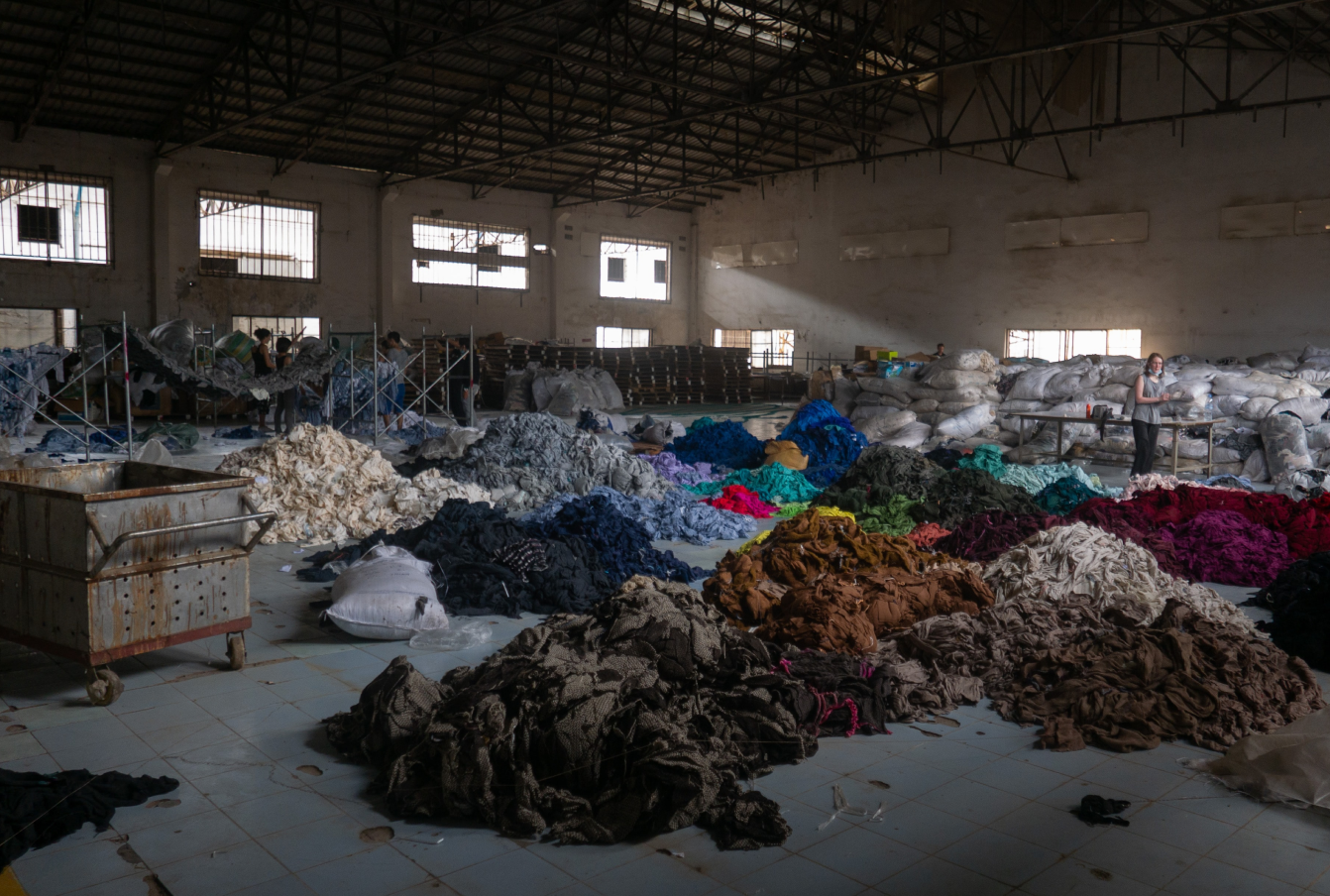 large piles of various coloured fabric