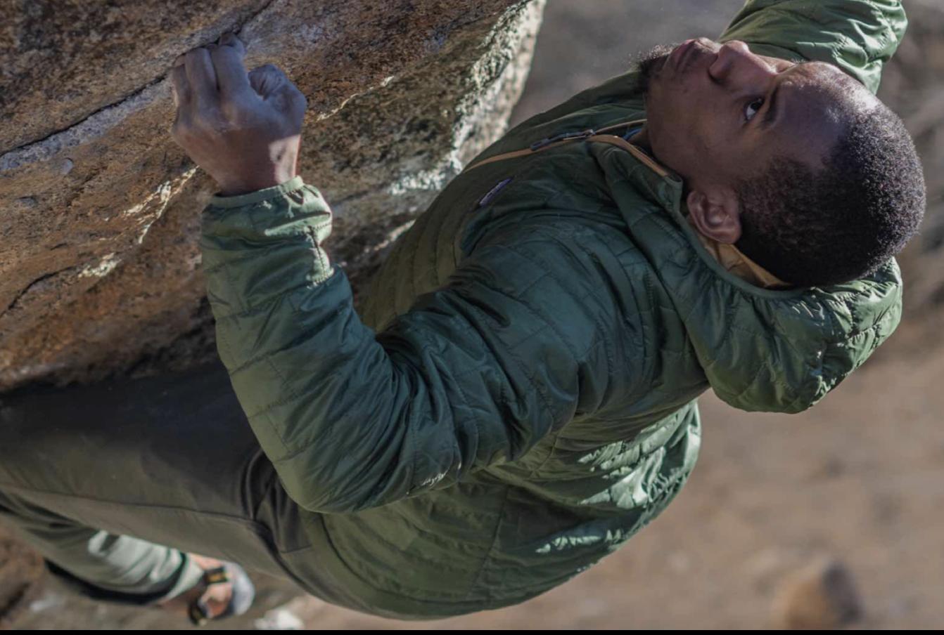 Man climbing a rock face