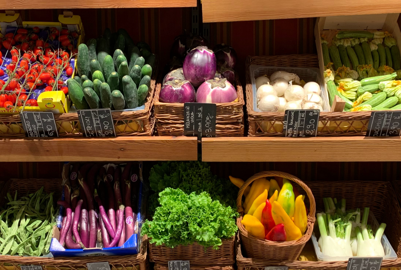 Vegetable produce in a grocery store aisle.