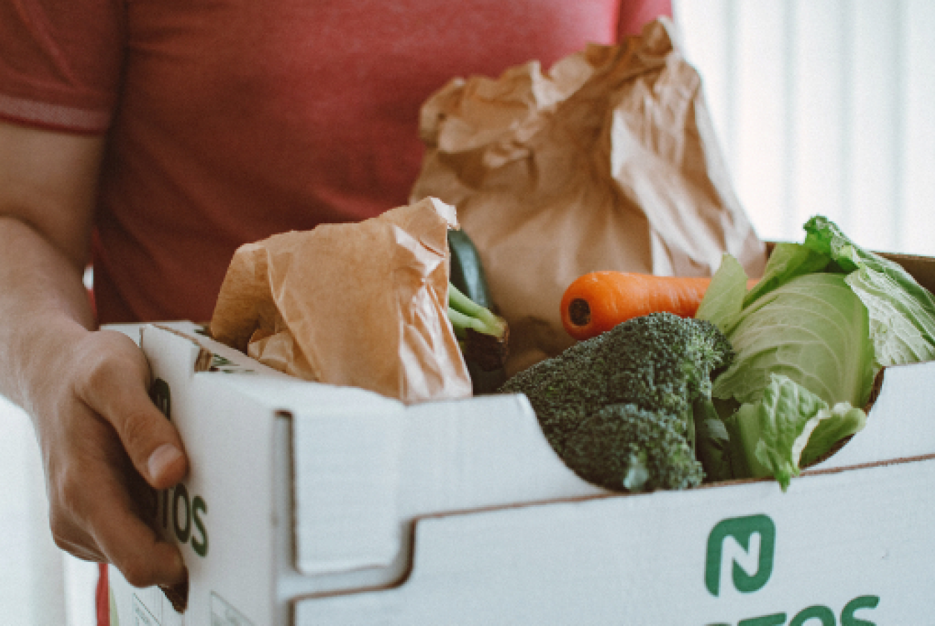 A meal kit delivery of vegetables being used for a meat-free meal
