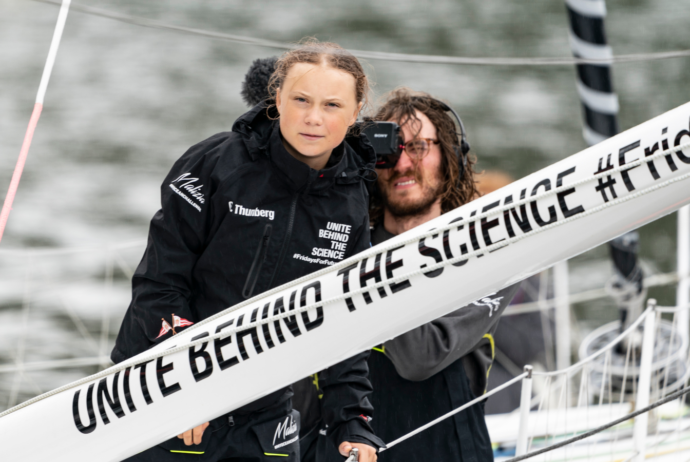Greta Thurnberg on a sailboat en route to COP19.