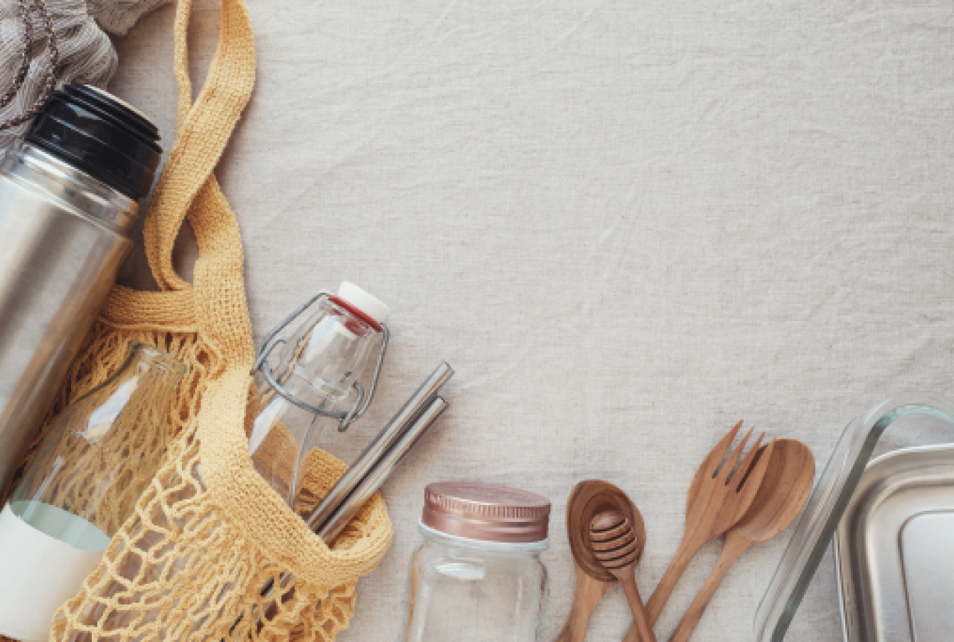 Plastic-free alternatives like wooden cutlery, metal straws, glass bottles and a coffee thermos.