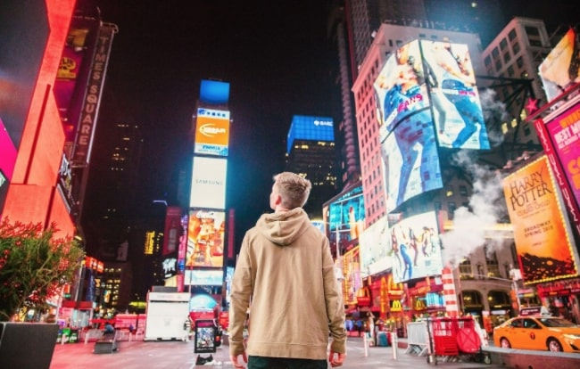 Person in the middle of Time Square in New York City
