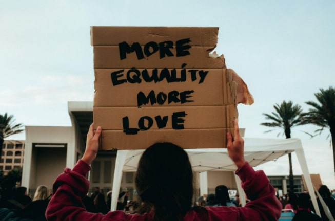 """Sign that says """"more equality more love"""""""