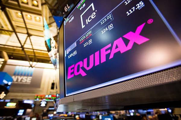 NYSE trading floor with Equifax on screen