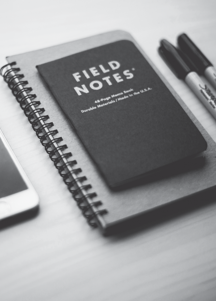 A notebook with the title field notes written on it