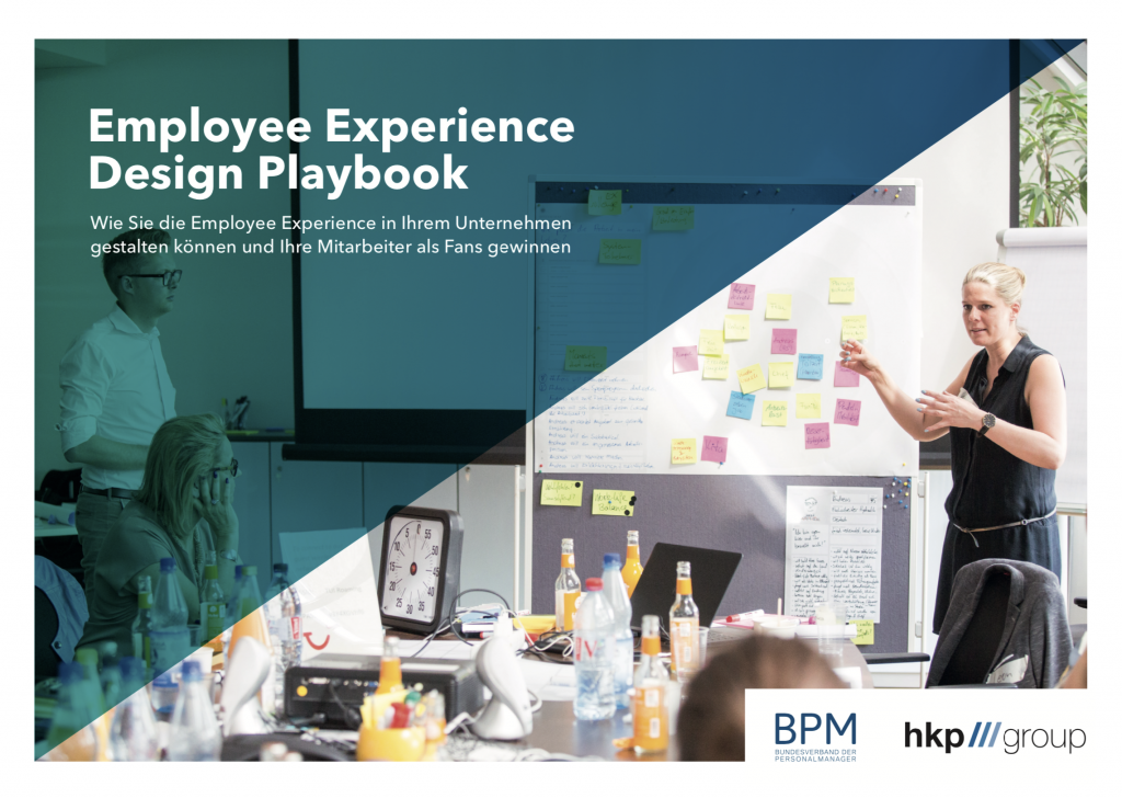 """photo of people in a seminar room with white boards, sticky notes and a speaker. An overlay with writing """"Employee Experience Design Playbook"""""""
