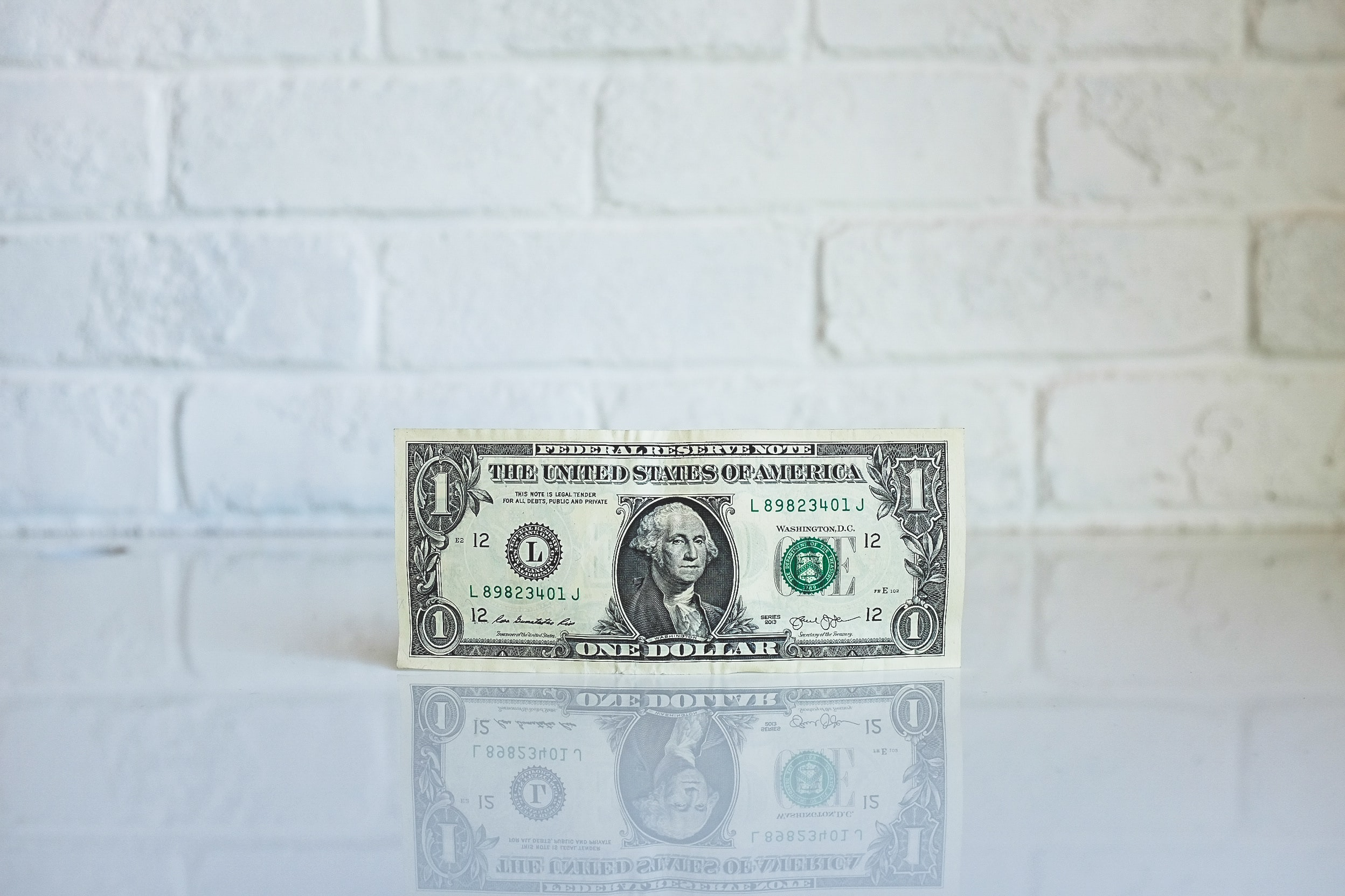 One dollar bill on modern kitchen countertop.
