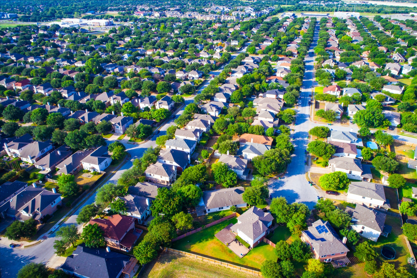 Aerial view of American neighborhood and homes.