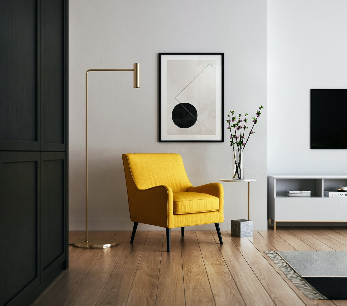 Mid-century home interior shown with bright yellow chair